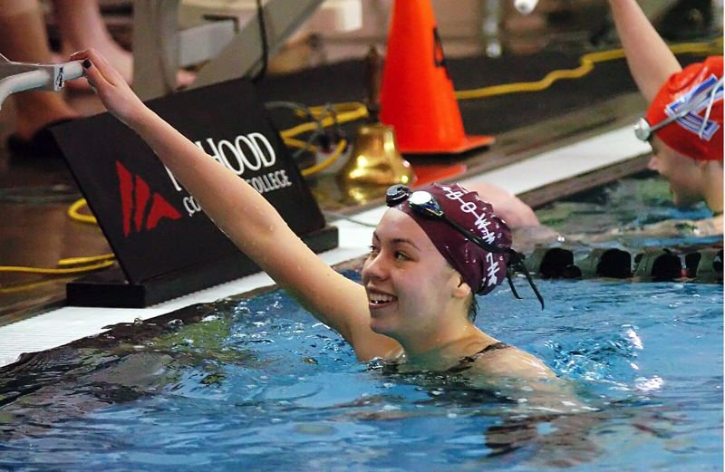 by: DAN BROOD - WINNING SMILE -- Sherwood High School junior Julia Bush is all smiles after her winning performance in the 100-yard freestyle event Saturday at the Class 5A state swimming championships.