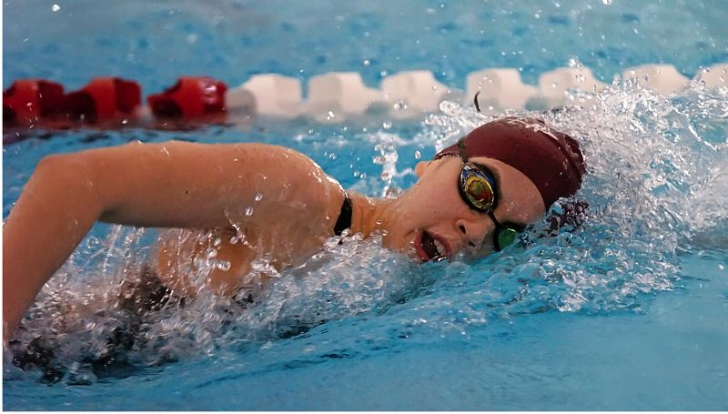 by: DAN BROOD - GOING FAST -- Sherwood High School junior Julia Bush is on her way to a second-place finish in the 200-yard freestyle event Saturday at the Class 5A state championships.