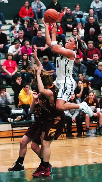 by: DAN BROOD - HIGH FLYER -- Tigard senior guard Lexi Carter goes up strong to the basket in the win over Forest Grove.