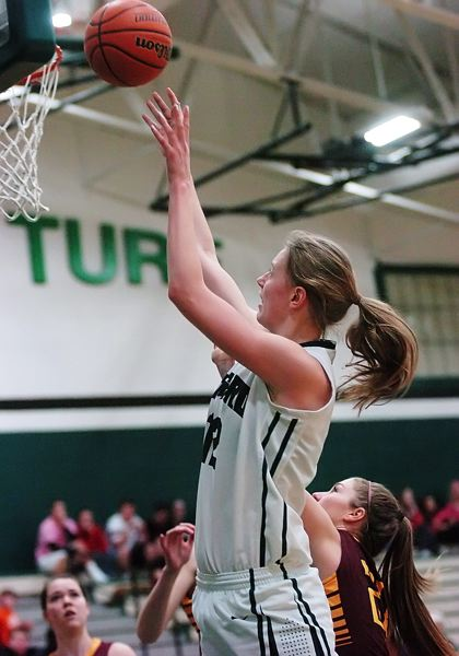 by: DAN BROOD - UP CLOSE -- Tigard sophomore post Elise Conroy shoots for two of her 12 points in the win over the Vikings.