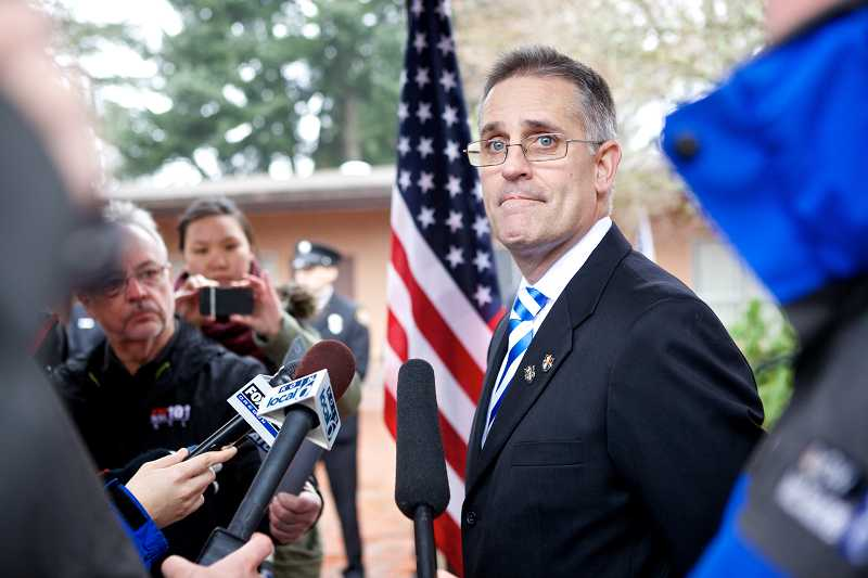 by: TIMES PHOTO: JAIME VALDEZ - Wendall Pelham, the father of U.S. Army Spc. John Alexander Pelham, speaks to the media following his son's funeral on Monday afternoon in Beaverton.