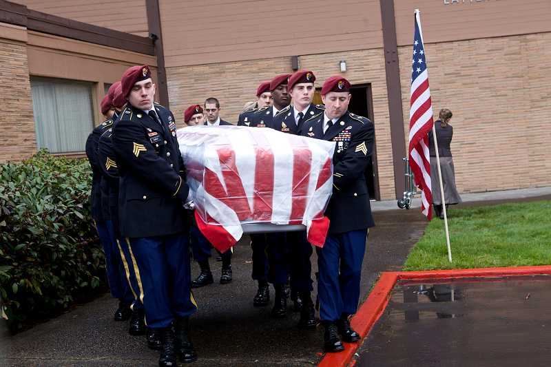 by: TIMES PHOTO: JAIME VALDEZ - Military honor guard pallbearers carry U.S. Army Spc. John Alexander Pelham's casket to a hearse Monday afternoon for burial at Willamette National Cemetery.