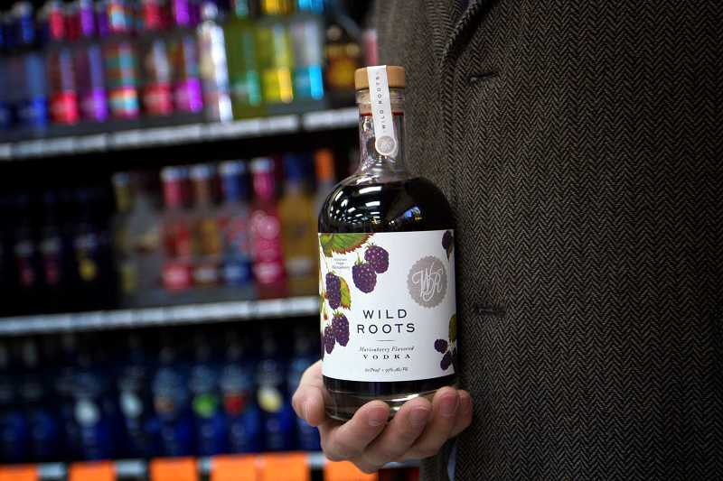 by: TIMES PHOTO: JONATHAN HOUSE - A bottle of Wild Roots infused vodka at the Beaverton Liquor Store.