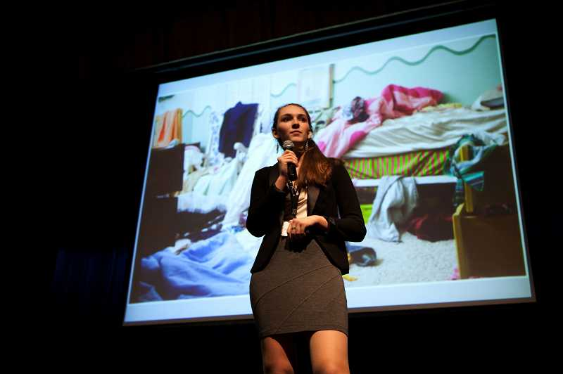 by: TIMES PHOTO: ADAM WICKHAM - Claudia Bueermann, a Catlin Gabel sophomore, presents her team's concept 'Hangit,' a program for organizing wardrobes.