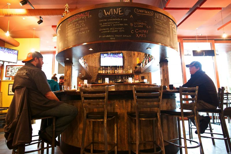 by: TRIBUNE PHOTOS: JAIME VALDEZ - The newest Lompoc Tavern inhabits the Benevento building on Northwest 23rd Avenue, contributing to a possible resurgence of dining spots on the busy street.