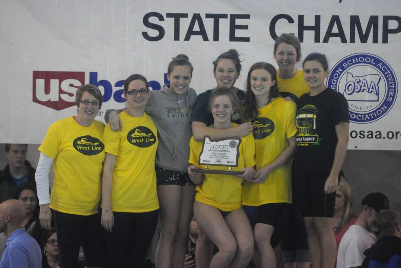 by: MATTHEW SHERMAN - West Linn's swim team stands with its second-place trophy following last week's state meet at Mount Hood Community College.