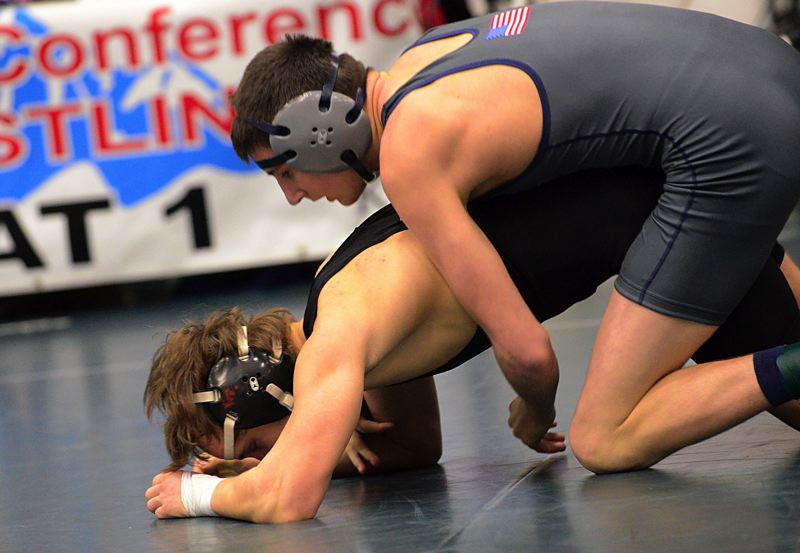 by: VERN UYETAKE - Lake Oswego's Brian Fay captured the regional crown at 126 pounds.