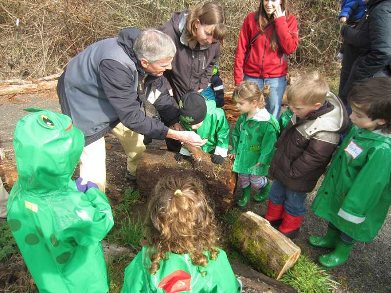 by: COURTESY OF FRIENDS OF TUALATIN RIVER WILDLIFE REFUGE - PUDDLE-STOMPING PRESCHOOLERS - Volunteer naturalists from the Friends of the Tualatin River Wildlife Refuge share time with a group of young children during the refuge's very popular 'Puddle Stompers' program.