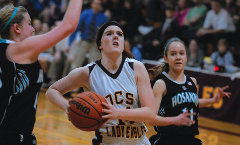 by: THE OUTLOOK: DAVID BALL - Damascus Christians Karissa Cox finishes off a fastbreak during the Eagles 74-32 playoff win over Hosanna Christian on Friday.