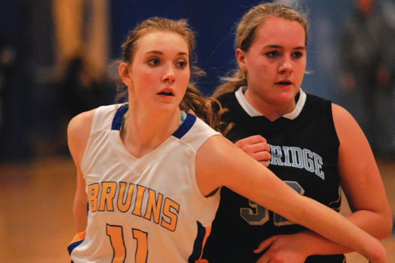 by: THE OUTLOOK: DAVID BALL - Barlows Haylee Hutzler works to box out Lakeridge center Maddie Rabing during the Bruins play-in victory Friday night.