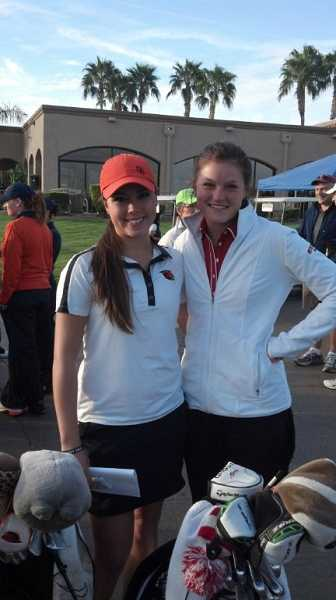 by: TERRY BAILEY / COURTESY - Canby girls golf alumnae Krissy Peterson (left) and Aaren Ziegler cross paths at a collegiate tournament in Arizona. Peterson and Ziegler represented Oregon State and Wisconsin, respectively.