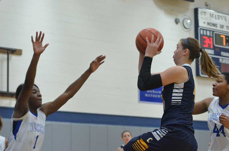 by: JEFF GOODMAN / FILE - The Canby girls basketball team is in the hunt for its first playoff win since 2007. Above, senior Rachel Erbe (right) attacks the basket in a nonconference game at St. Mary's Academy in Portland.