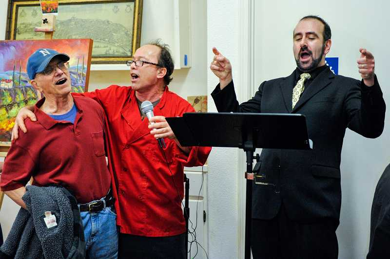 by: TIMES PHOTO: JOHN LARIVIERE - Tony Russo (left) and Domenico Mimmo Russo accompany Anton Belov in a sing-along of the well-known Italian song 'Funiculi - Funicula.' Tony, from Newberg, and Domenico, from Sherwood, are not related, but became good friends when they discovered they both grew up in the same region of Napoli in Italy.