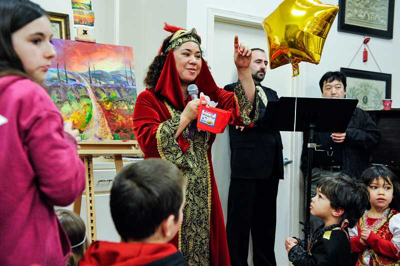 by: TIMES PHOTO: JOHN LARIVIERE - Italian Carnevale event coordinator Angelisa Russo keeps children in suspense as she calls out winners of one of the many raffle prizes offered during the afternoon.