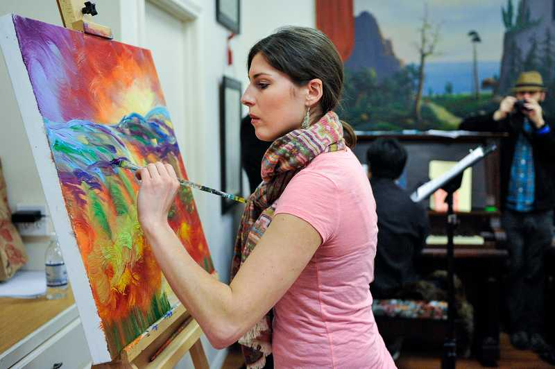 by: TIMES PHOTO: JOHN LARIVIERE - Jen Harlow from the Blue Plume Art Studio paints a Tuscany landscape as part of an art demonstration and education display at the Sherwood Italian Carnevale held at the Rebekah Lodge on Sunday.