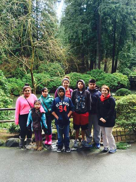 by: SUBMITTED PHOTO - The Tigard Bahai youth group works on charity projects together as well as fun recreational pursuits.