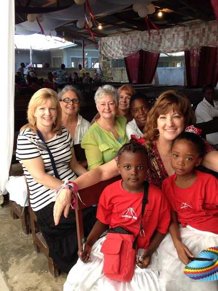 by: SUBMITTED PHOTO - Members of the 2014 Beaverton Christian Church mission team spent Jan. 5 to 15 in Haiti where they distributed clothing, shoes and food to more than 1,500 children and their families.