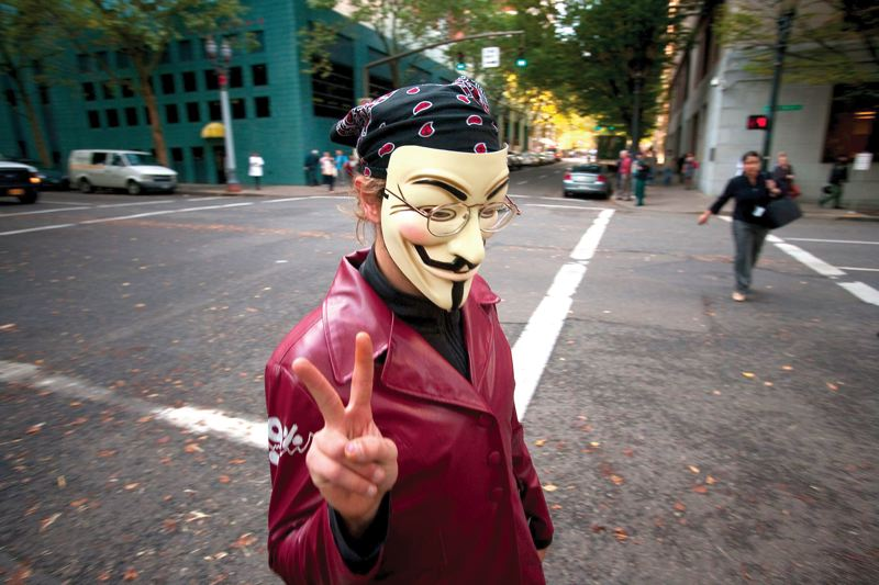 by: TRIBUNE FILE PHOTO: CHRISTOPHER ONSTOTT - Members of the Occupy Portland movement took over part of downtown in mid-October 2011, with many dressed in Guy Fawkes masks from the 2005 movie V for Vendetta.