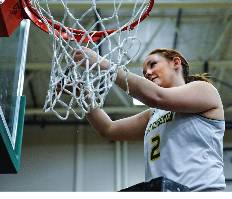by: JOHN LARIVIERE - Putnam senior leader Ali Schooley takes her turn claiming a piece of the net as a souvenir after Friday nights decisive win over Wilsonville. With the win, the Kingsmen finished 14-0 in the Northwest Oregon Conference.