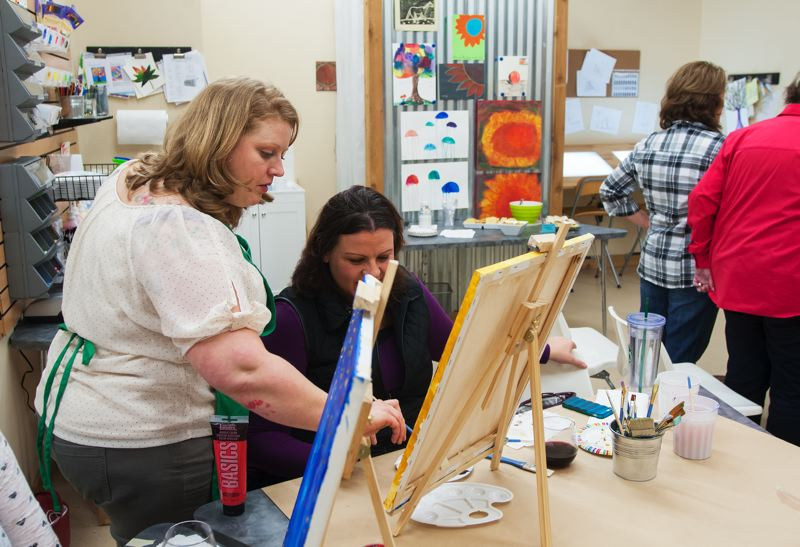 by: SPOKESMAN PHOTO: JOSH KULLA - Boeckman Creek Primary School art teacher Corrie Sammon moonlights at the new ALT Creative Studio in Old Town Wilsonville.  Sammon leads a popular womens wine and paint class.