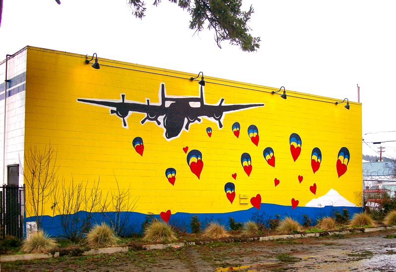 by: RITA A. LEONARD - The Love Bomb wall mural by Tim Janchar provides a Valentine scene every day of the year at the corner of S.E. Woodstock Boulevard and 82nd Avenue of Roses.