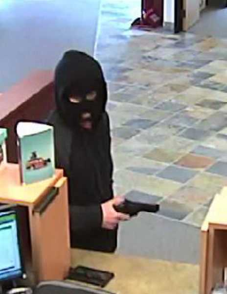 by: SUBMITTED - This man robbed Woodburn's Maps Credit Union Tuesday and got away with an undisclosed amount of cash. Anyone with information on this case is asked to call 503-982-2345.