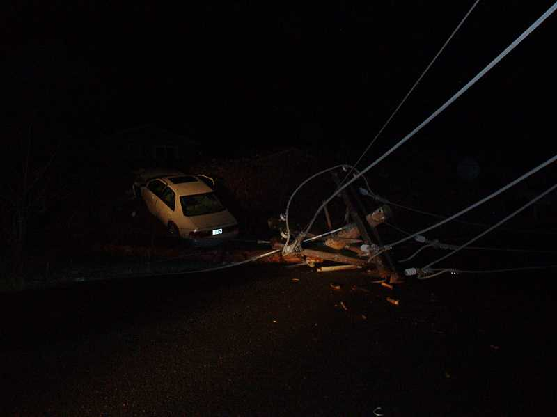 by: CLACKAMAS COUNTY SHERIFF'S OFFICE - The impact of crash sheared off the power pole, causing loss of power for local residents