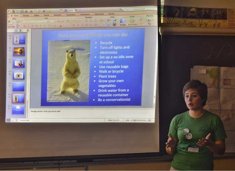 by: RAY HUGHEY - Canby High senior Lilly Pruitt tells students how global warming impacts polar bears and what they can do to help.