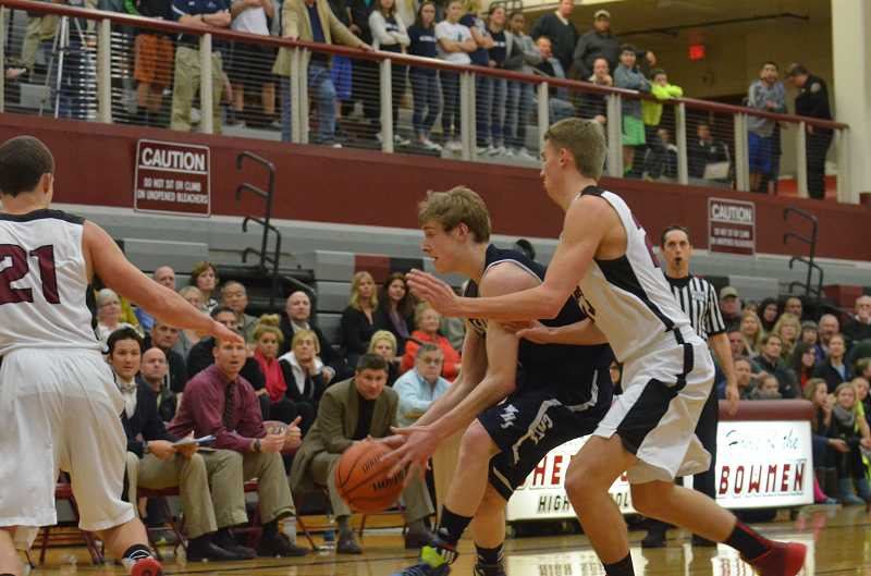 by: JEFF GOODMAN / PAMPLIN MEDIA GROUP - Tyler Hieb is guarded tightly during the Wilsonville boys basketball team's Feb. 25 game at Sherwood. The Wildcats scored just four points in the third quarter as the Bowmen guaranteed at least a share of the conference title.