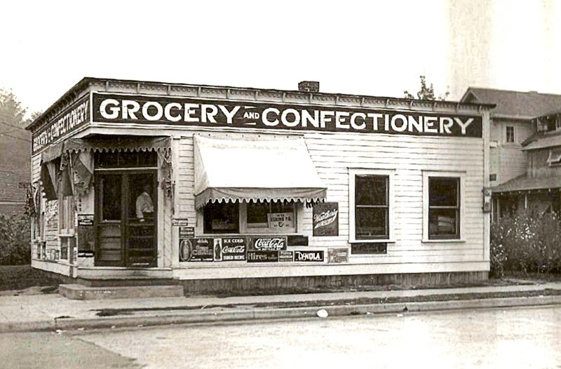 by: PHOTO COURTESY OF CHUCK MARTIN - Soder Brothers opened a grocery and confectionery at the corner of Miller and S.E. 7th, hoping to garner the traffic of school children after a summer afternoon swim in the Sellwood Pool. This 1922 photo shows, in the doorway, one of the Swedes who owned their own business in Inner Southeast. This store has long since been converted into a home, but is still located across the street from Sellwood Park.