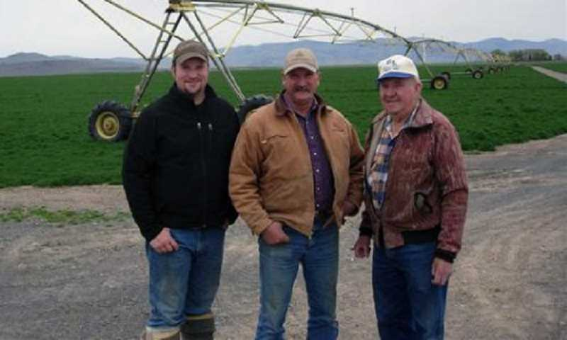 by: SUBMITTED PHOTO - Three generations of the Klann family at the farm, from left, Seth, Brand and Harold Klann.