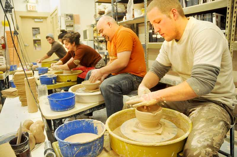 by: GARY ALLEN - Group effort - In November, 40 students, alumni, professors and other professional and amateur artists came together to throw the ceramic bowls that will be given away at the Empty Bowls fundraiser Friday.