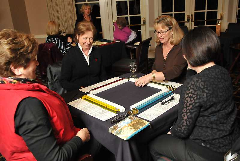 by: TIDINGS PHOTO: VERN UYETAKE - Lynda Brynelson of West Linn at first didn't want to go out at night to play mahjong in Lake Oswego. But now she is there almost every Thursday night.
