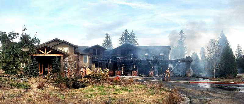 by: COURTESY OF ESTACADA RURAL FIRE DISTRICT NO. 69 - Two men, James Carden and Richard Gardner, are suspected of causing a fire that engulfed this home on South Feldheimer Road in Estacada on Tuesday, Feb. 25.