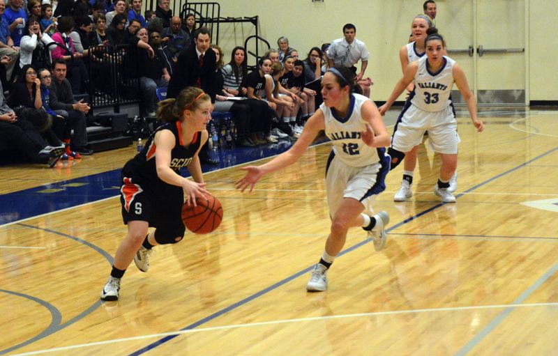 by: TIMES PHOTO: MATT SINGLEDECKER - Valley Catholic senior guard Addie Flemmer tries to fluster Scios point guard in the first quarter of the Valiants win over the Loggers on Friday.