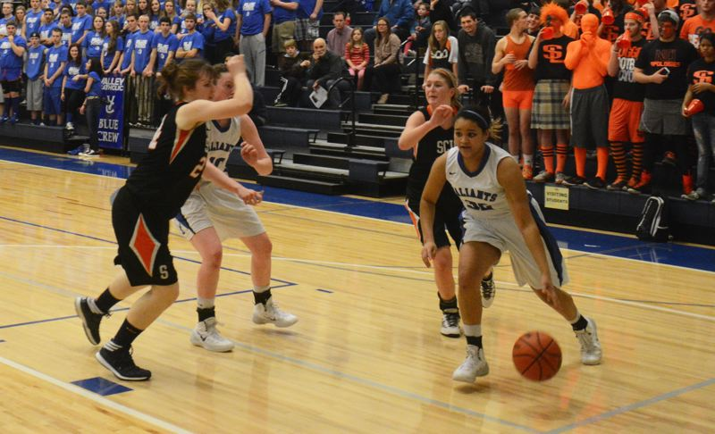 by: TIMES PHOTO: MATT SINGLEDECKER - Valley Catholic junior wing Kaylynn Bush drives past the Scio defense on her way to the basket for two.