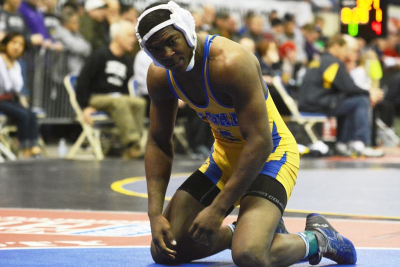 by: TIMES PHOTO: MATT SINGLEDECKER - Aloha senior 170-pound Maurice McSwain shook off a semifinal loss at the 6A state tourney to place third overall on Saturday.