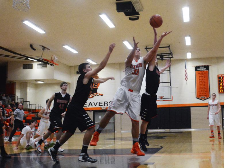 by: TIMES PHOTO: MATT SINGLEDECKER - Beaverton junior post Jared Hilbers fights for a loose ball in the third quarter of the Beavers play-in win over Roseburg on Saturday. Hilbers had 12 points.