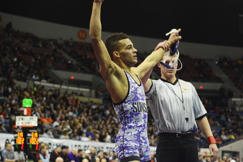 by: TIMES PHOTO: MATT SINGLEDECKER - Sunset junior 138-pound Spencer Stokes took second place at the 6A state championships on Saturday, beating Forest Groves Cody Smith, 15-6.