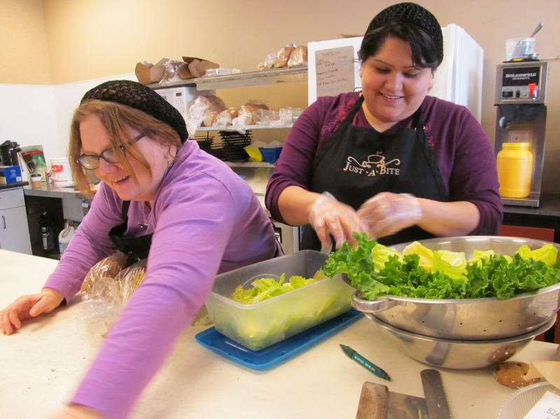 by: PHOTO BY ELLEN SPITALERI - Lori Reyes, left, and daughter, Liz Reyes, make a point of hand tearing freshly cut lettuce, before using it in salads and sandwiches.