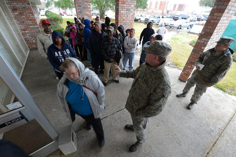 by: PHOTO COURTESY: U.S. MILITARY - Abbeville-area residents line up for health care where the military has set up in a former nursing home.