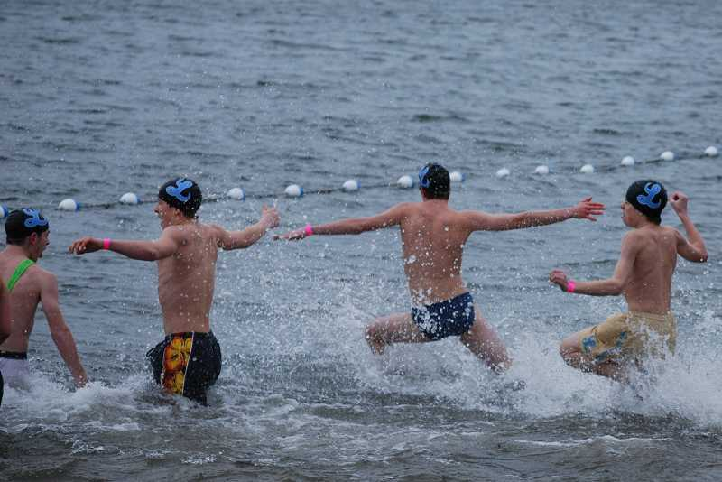 by: SUBMITTED PHOTO - Pacers, from left, Alex Brivic, Lucas Diamond, Cory Barba and Nathan Barba plunged into the Columbia River to support Special Olympics Oregon.