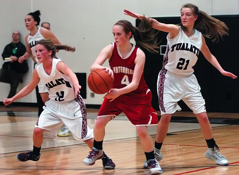 by: DAN BROOD - TOUGH ON DEFENSE -- Tualatin seniors Madi Hall (left) and Lindsay Barrow (21) keep the pressure on Centennial's Melissa Dailey in Tuesday's state playoff game.
