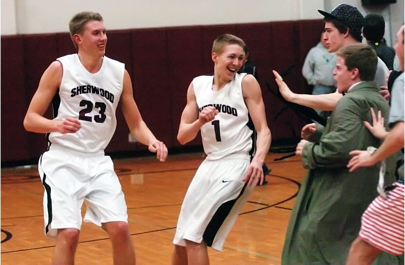 by: DAN BROOD - GOOD TIMES -- Sherwood senior Lucas Johnson (23) and junior Evan Kitto celebrate with Sherwood students following the title-clinching win over Liberty.