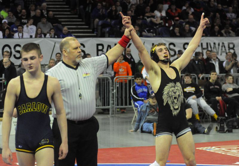by: MATTHEW SHERMAN - Tim Harman celebrates his state championship at 145 pounds at the Memorial Coliseum Saturday. Harman became the first wrestler in West Linn history to complete an undefeated season.
