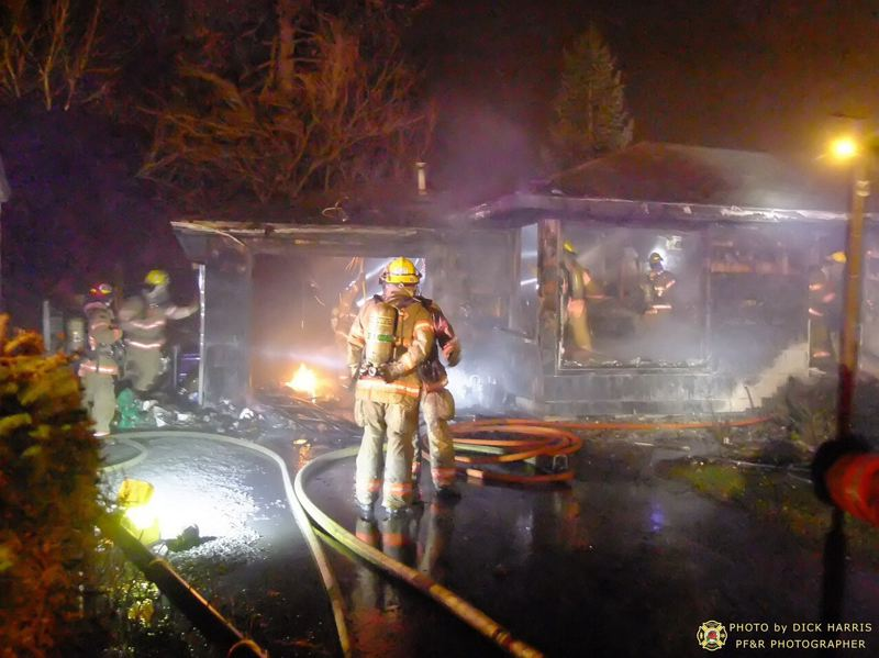 by: DICK HARRIS, PORTLAND FIRE & RESCUE - This fire at 15908 SE Alder St. is one of two house fires early Thursday.