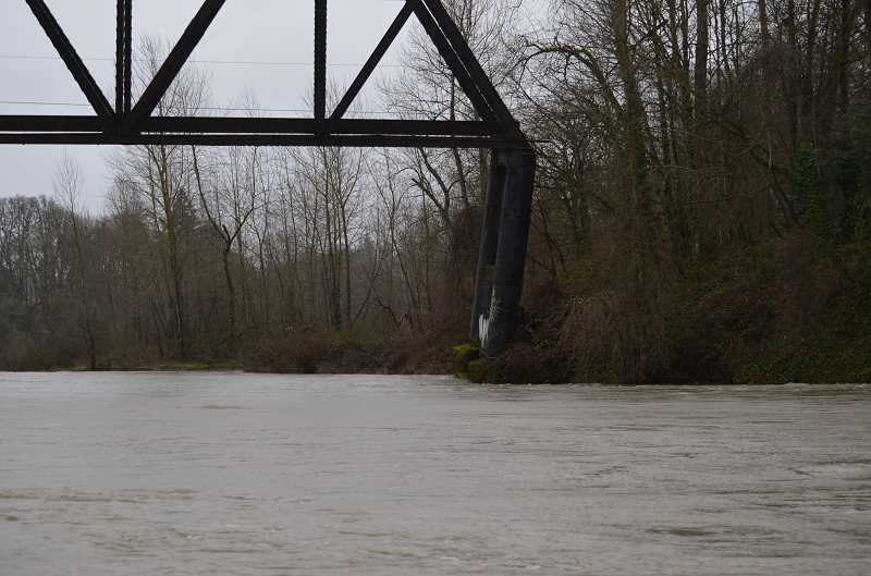 by: CLACKAMAS COUNTY - The bridge piling is tilting towards Oregon City and downriver