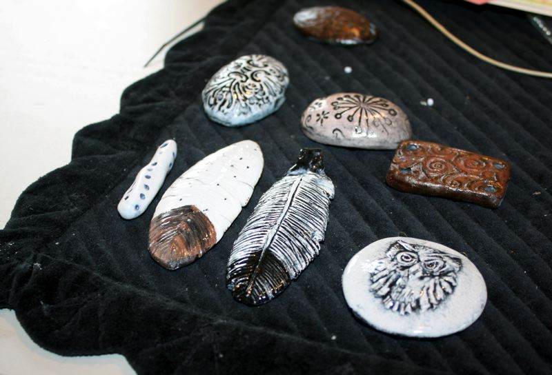 by: POST PHOTO: KYLIE WRAY - The jewelry that Goebel sells is handmade and features intricate pottery pendants.