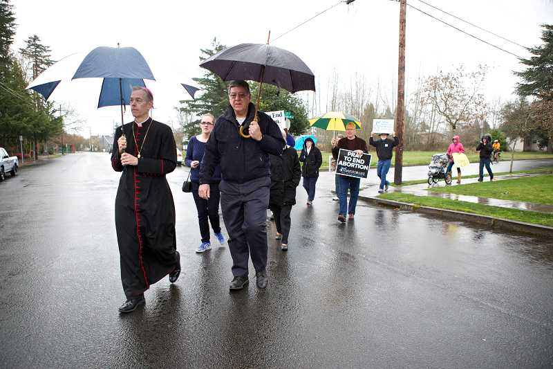 by: TIMES PHOTOS: JAIME VALDEZ - Archbishop Alexander K. Sample leads Catholics to the Planned Parenthood clinic in Beaverton after an 8 a.m. Mass at St. Cecilia Catholic Church.