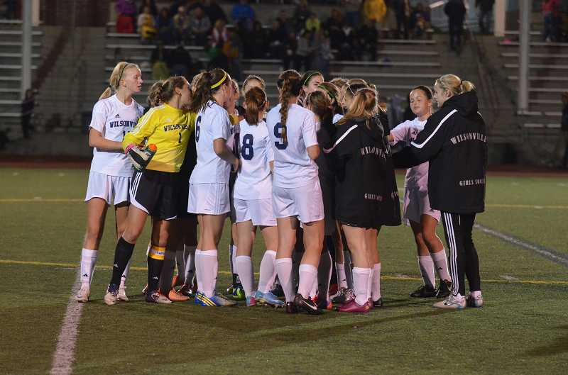 by: JEFF GOODMAN / FILE - Wilsonville High School will face La Salle Prep and Hillsboro in Northwest Oregon Conference action starting in 2014-15. Above, members of the WHS girls soccer team huddle at Randall Stadium.